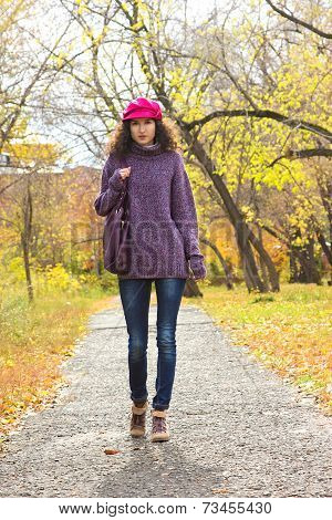 Young Beautiful Woman Walking Along Autumn City Park
