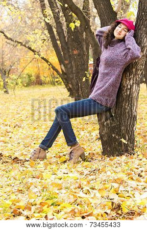 Young Beautiful Woman Resting In Autumn City Park