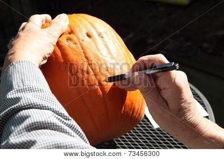 Designing face for Halloween pumpkin