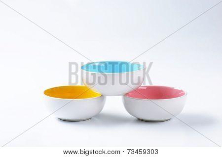three empty bowls formed into pyramid