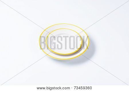 broad plates with yellow edges