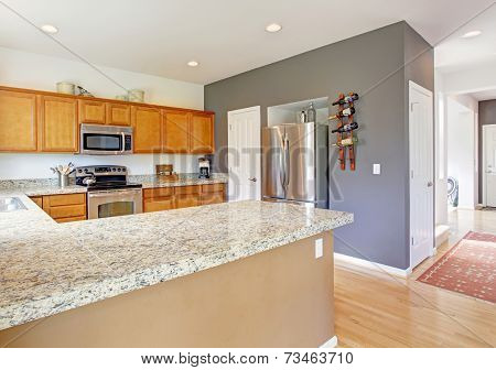 Kitchen Room With Granite Tops And Steel Appliances