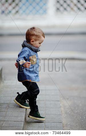 little boy walks alone on stairway