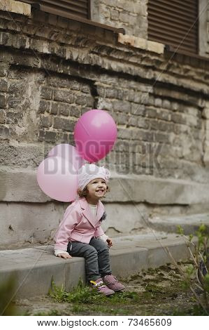 Cute girl with pink balloons portrait