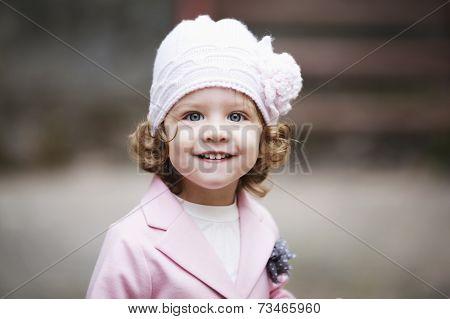 little curly hipster girl urban portrait