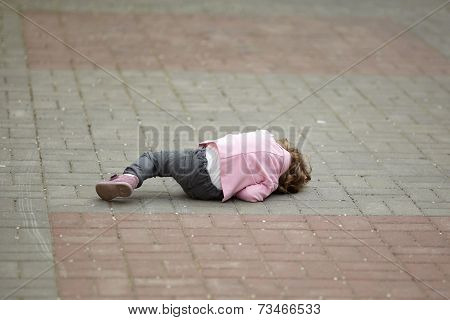 alone crying girl lying on asphalt