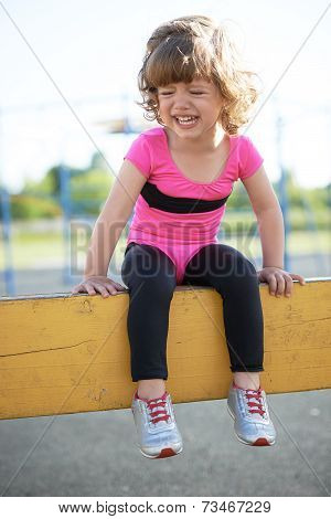 unhappy girl crying on the playground