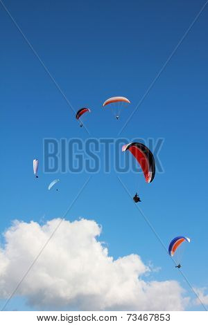 Group Of Paragliders In The Sky