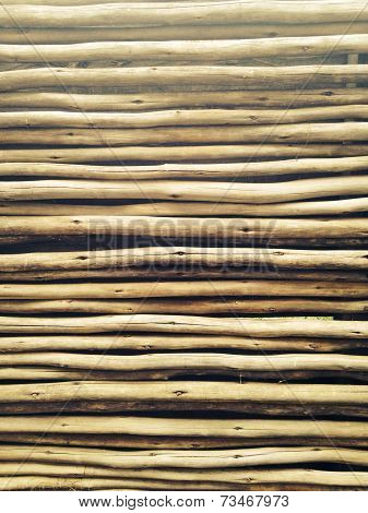 Wooden pole wall