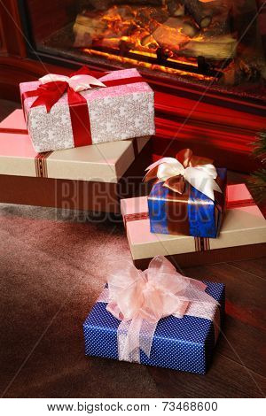 Christmas gift boxes in the interior with a fireplace