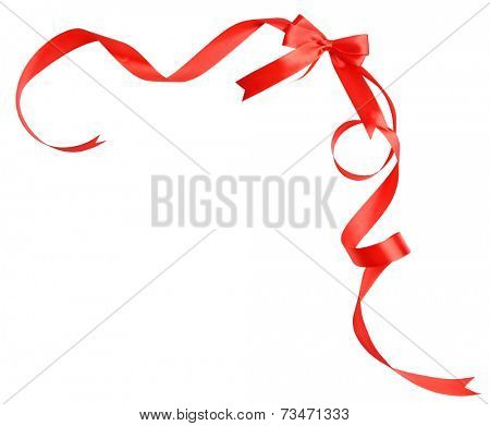 Shiny red satin ribbon and bow isolated on white