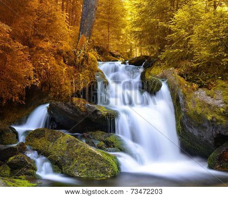 Autumnal landscape with waterfall in National park Sumava,Czech Republic,Europe