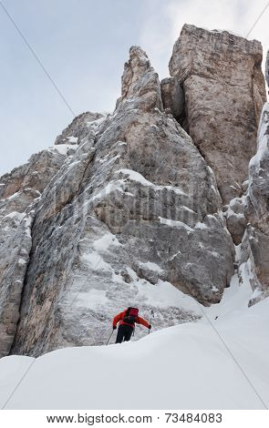 Mountaineer on the snowy steep north face of Torri di Falzarego peak - Cortina d'Ampezzo, Dolomiti, Italy, Europe.