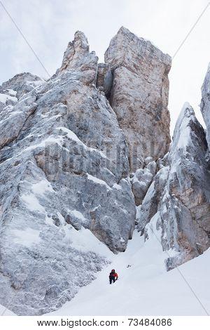 Mountaineer on the snowy steep north face of Torri di Falzarego peak - Cortina d'Ampezzo, Dolomiti, Italy, Europe.