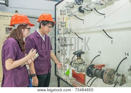 Chemical Engineer Student Checking Equipment In Control Room For Training