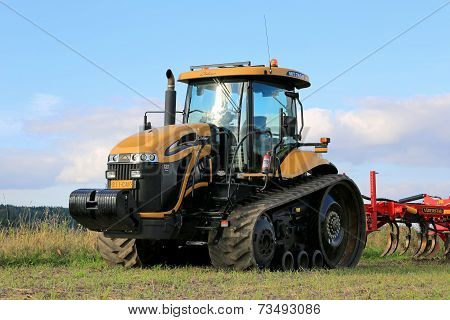 Challenger Agricultural Crawler Tractor On Field In Autumn