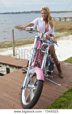 Sexy Blond Woman In Bikini And Shorts On Chopper Motorbike