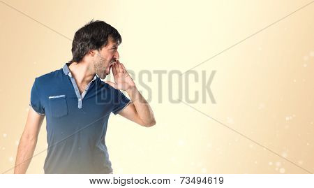 Man Shouting Over Ocher Background