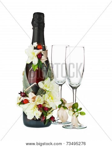 Champagne Bottle And Glass With Wedding Decoration Of Flower Arrangements.