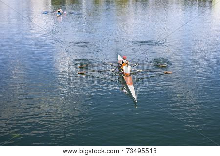 Two Women Rower In A Boat