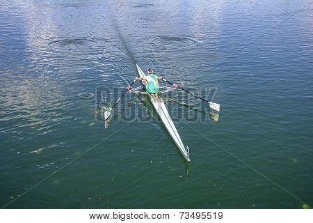 Women Rower In A Boat