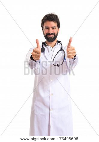 Doctor With Thumbs Up Over White Background