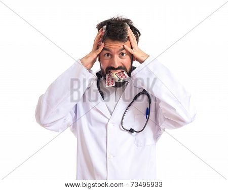 Frustrated Doctor With Pills Over White Background