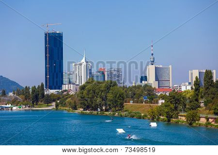Waterskiing In Vienna With Modern City Skyline On Background