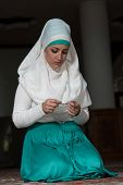 foto of tasbih  - Young Muslim Woman Praying In Mosque  - JPG