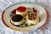 image of panna  - fancy panna cotta with blueberries and green little pistachio - JPG