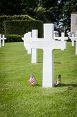 stock photo of headstones  - White headstone of an unknown soldier and US flags - JPG