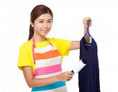 pic of knitwear  - Asian housewife use dust remover on knitwear - JPG