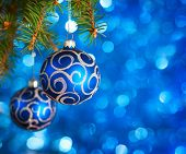 stock photo of blue spruce  - Christmas Baubles on light blue background with sparkles  - JPG