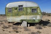 stock photo of travel trailer  - Classic old Vintage Travel trailer in Sonoran Desert of Southwest Arizona and Mexico - JPG