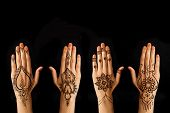 stock photo of mehendi  - hand with henna tattoo mehendi on black background - JPG