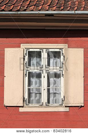 Window With Shutters In An Old Wooden House