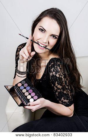 Beautiful girl with cosmetics
