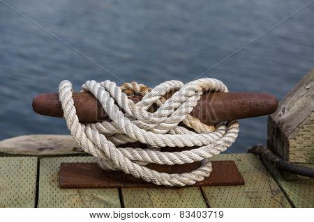 White Rope On Rusty Cleat