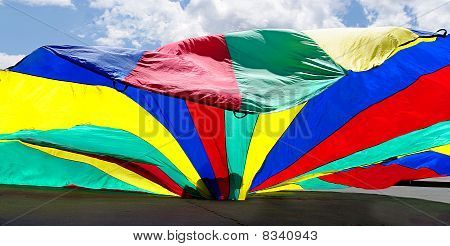 Colorful parachute playtime silhouette