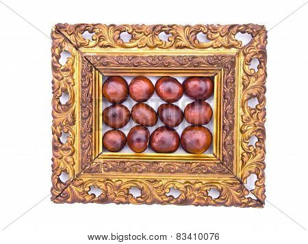 Conker Fruits In Antique Ornate Picture Frame Isolated
