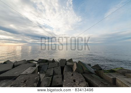 Breakwater In The Sea With Lighthouse On It