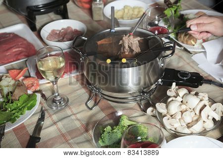 A fondue dinner with friend on a beautiful place