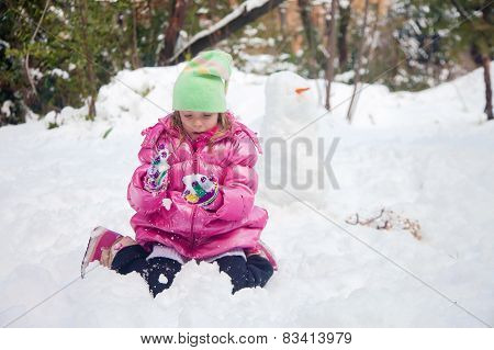 Little Blonde Girl Playing In The Snow
