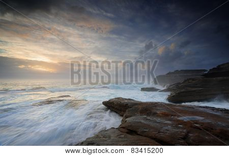 Wild Ocean Surges Over Steadfast Rocks