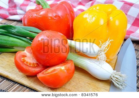 Concept Of Peppers, Tomatoes And Onions With Knife