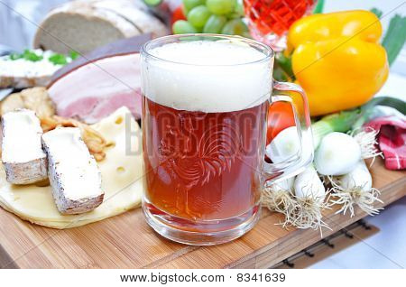 Meal Concept With Bread, Onion, Tomatoes, Cheese, Beer, Bacon And Pepper.