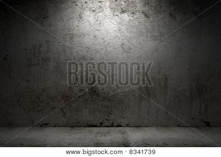 empty room with grunge concrete wall and cement floor