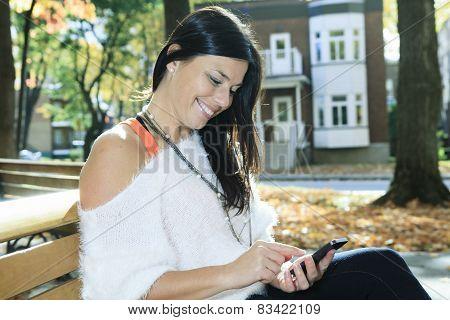 A beautiful autumn woman having good time.