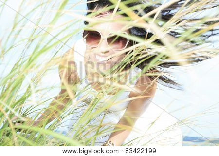 A Woman with Glasses  and Long Grass