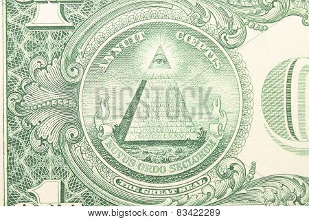 Part of one dollar note with great seal